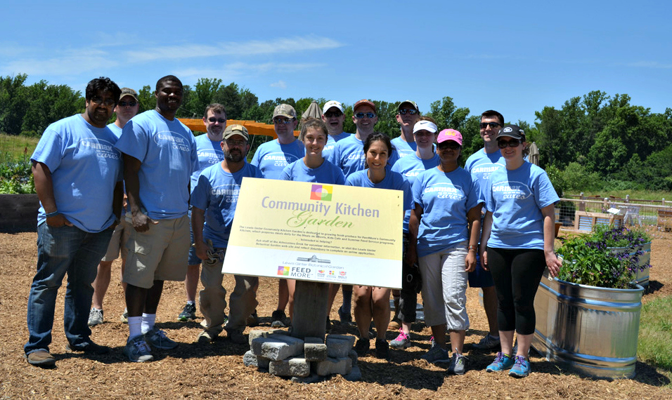 group of carmax associates posing in the community kitchen garden