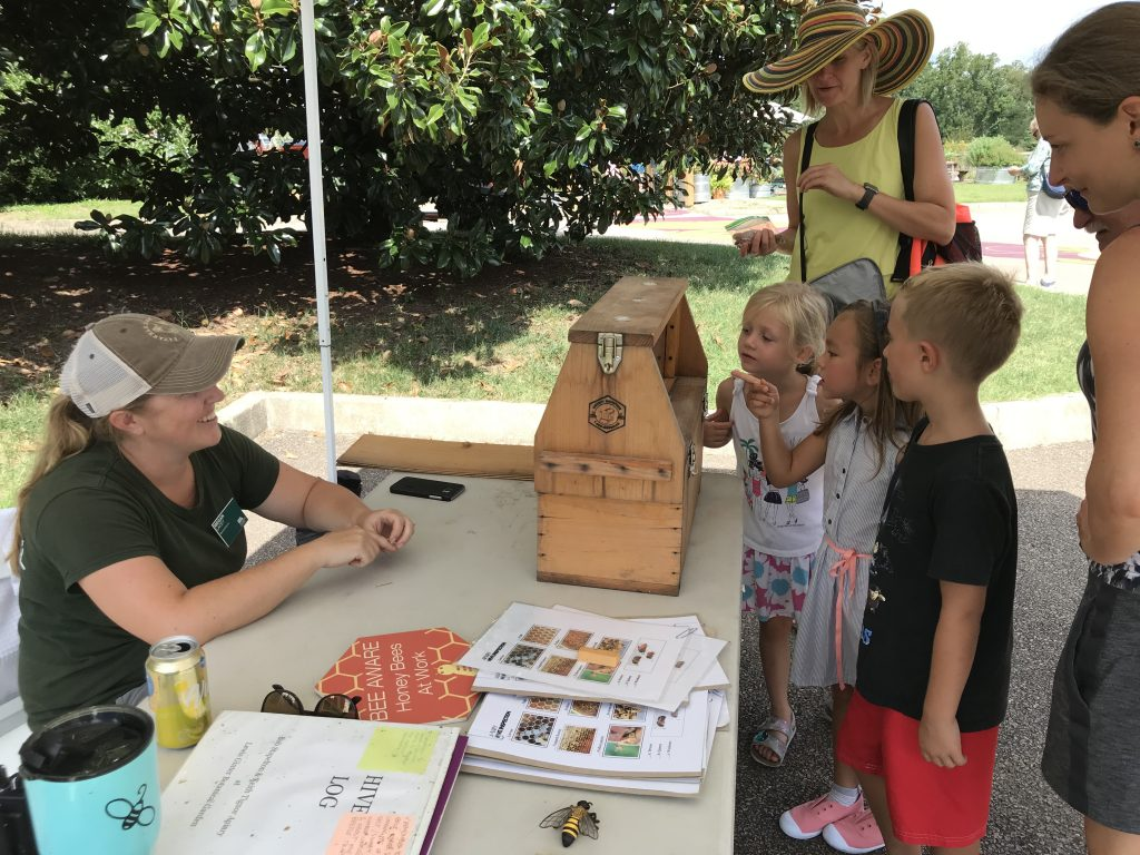 Kids learning about pollinators and bees at Genworth Free Community Day