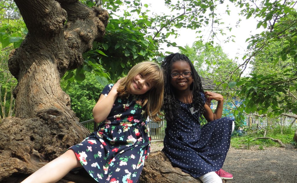 Girls in the Mulberry Tree in the Children's Garden