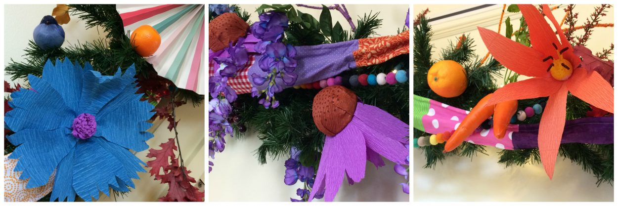 Crepe paper flower decorations in blue, purple and orange. A great DIY project.