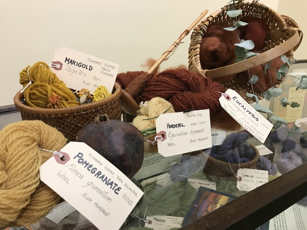 Part of the spinning demonstration is a colorful display of natural fibers colored with natural dyes, from pomegranate to eucalyptus.