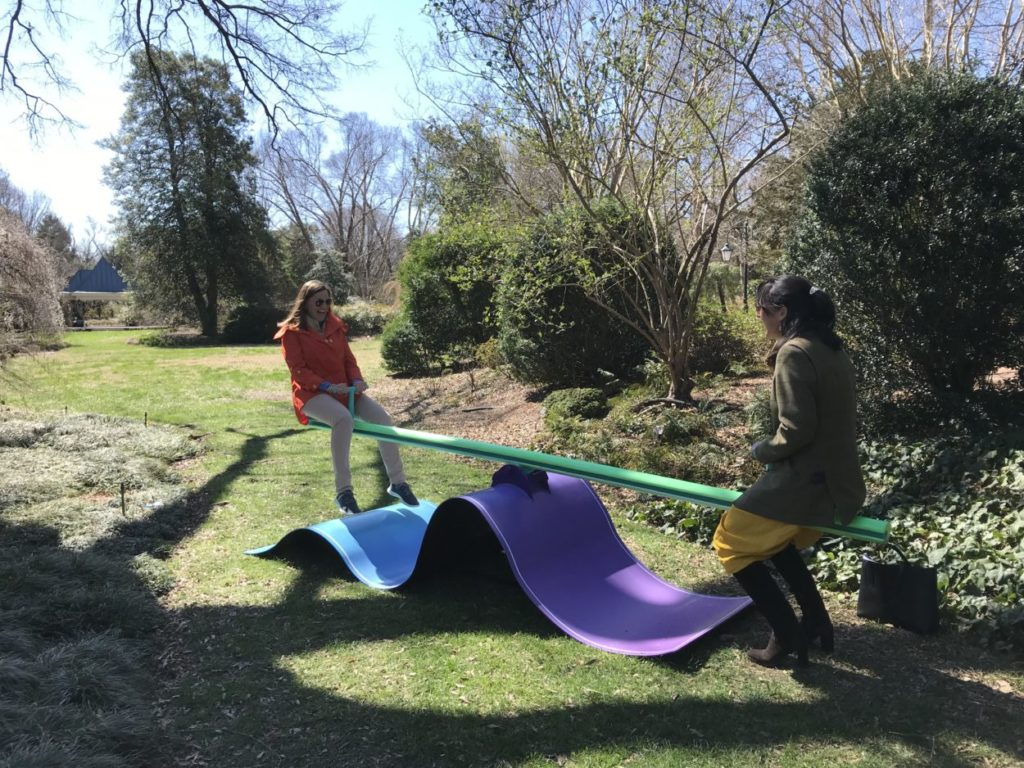 Ladies laughing on Moon Bounce by Mickael Broth at Lewis Ginter Botanical Garden