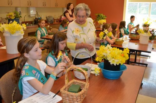 Margaret Ford teaching Girl Scouts about daffodils