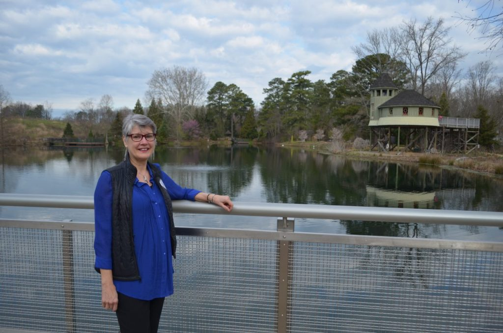 Brenda Bartges, Volunteer, on the Lotus Bridge at Lewis Ginter