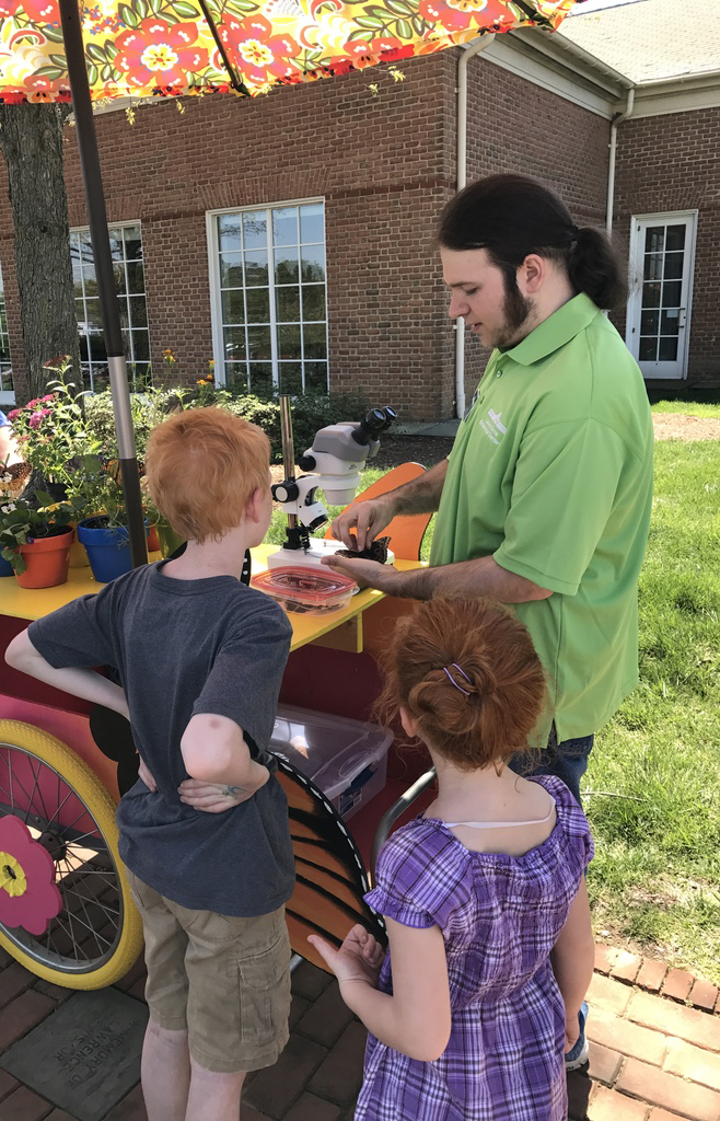 butterfly curator Elliott Phillips engaging kids in Butterfly education
