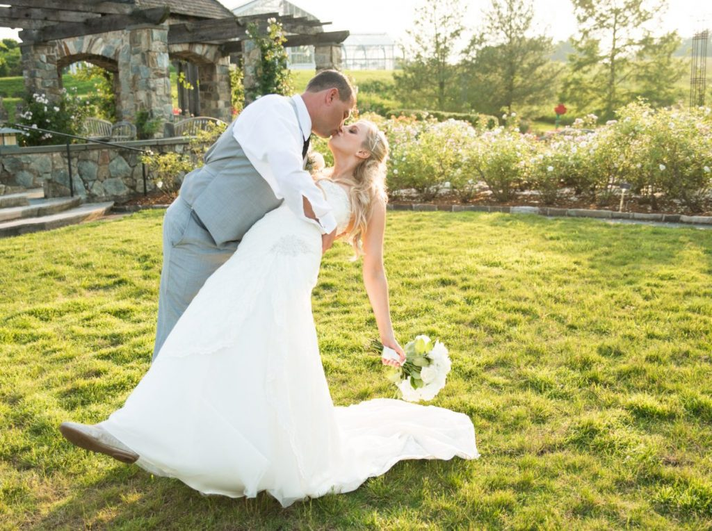 Outdoor weddings at the Rose Garden surround you with rose blooms. Image by Caroline Martin Photography.
