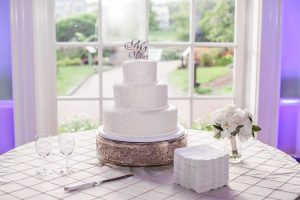 Wedding cake overlooks Central Garden. Image by Caroline Martin Photography.