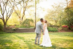 Newly married couple taking pictures throughout Flagler Garden. Image by Joanna Hartsook Photography.