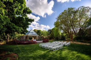 Outdoor weddings at Flagler Garden surround guests with blooms and greenery. Image by Marek K Photography.