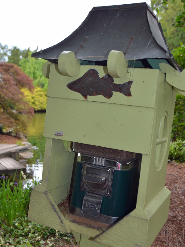 Fish food dispenser at the Garden
