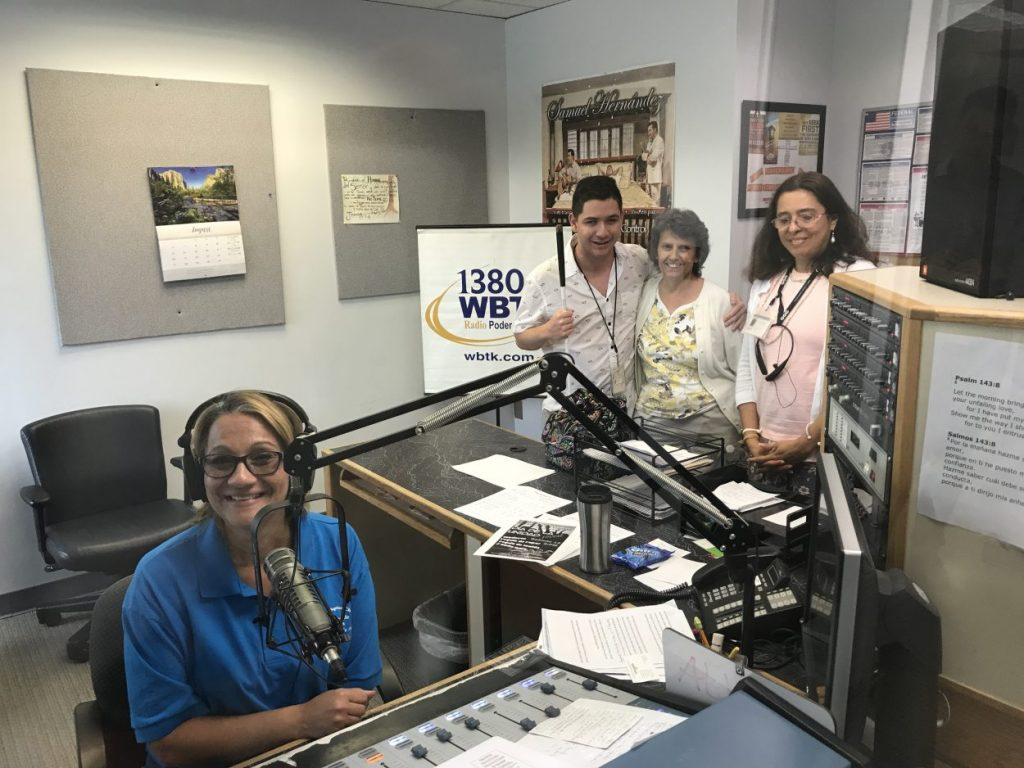 A tour of the radio station with show host Arlene Guzman at the mic.