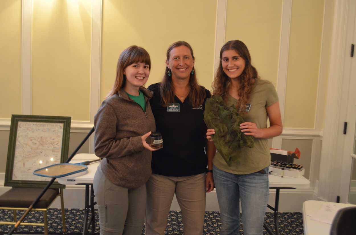 Devon Scanlan, Laurel Matthew, and Kaitlyn Paulchell stand with algal and macroinvertebrate samples