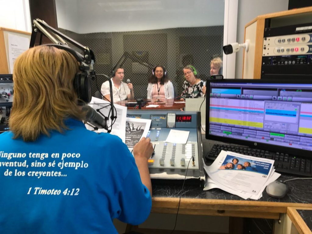 show host Arlene Guzman running the community focus program live on WBTK radio 1380 AM.