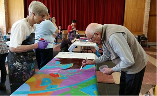 Visitors painting an interactive mural art