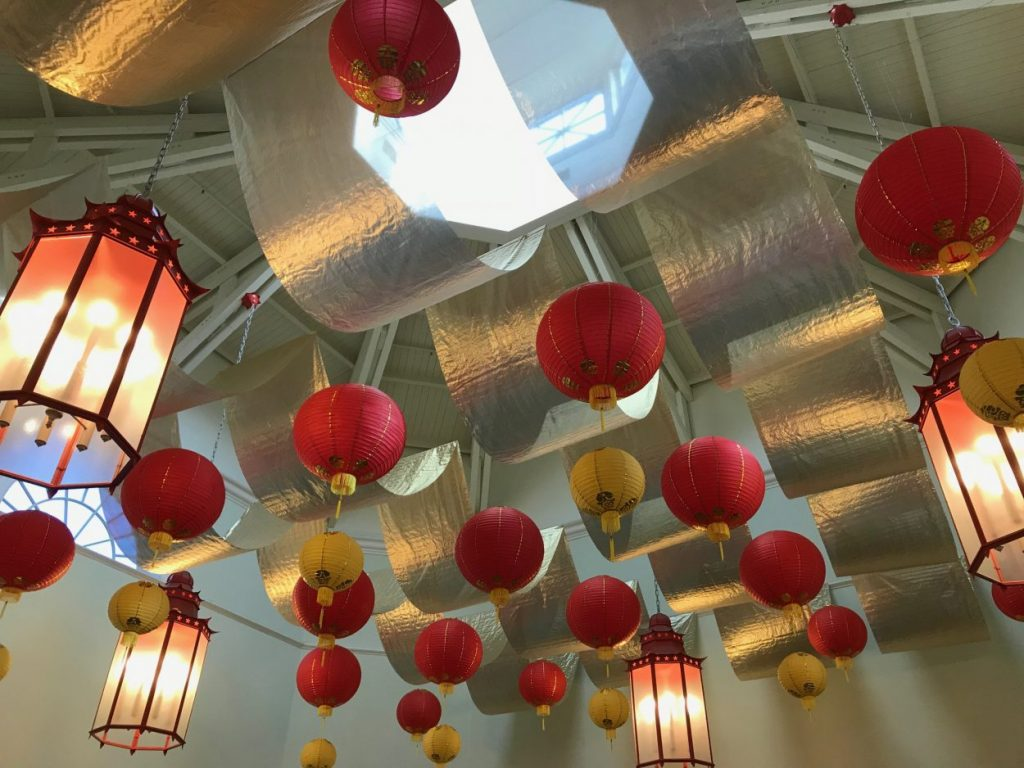 Lanterns and gold fabric on the ceiling