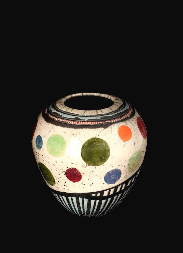 Colorful pottery in white, green, orange and blue.
