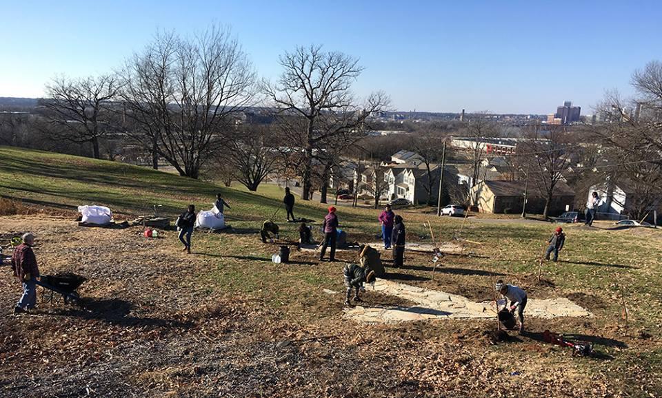 Teamwork: Ginter Urban Gardeners group laying stone in a new urban garden in Richmond, VA.