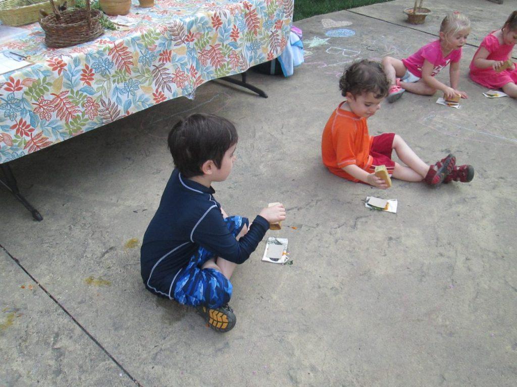Boys making art with petal pounding