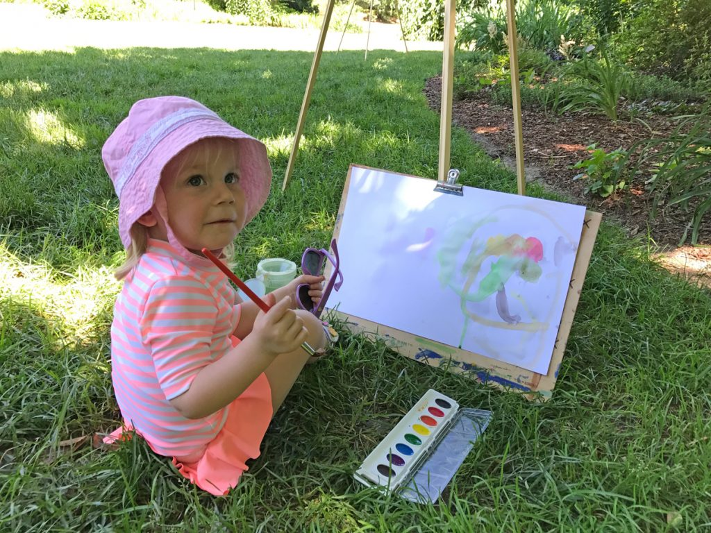 girl painting outside en plein air