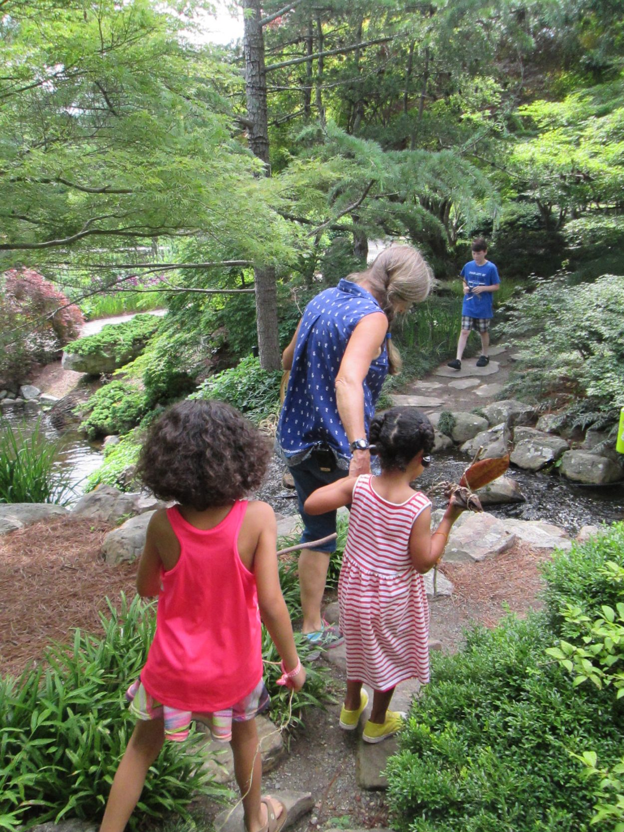 kids walking on a family walk and talk through the garden - Lewis Ginter Botanical Garden