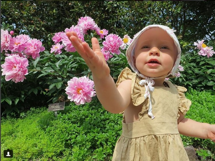 Girl with peony flowers, the #MillionBlooms contest winner