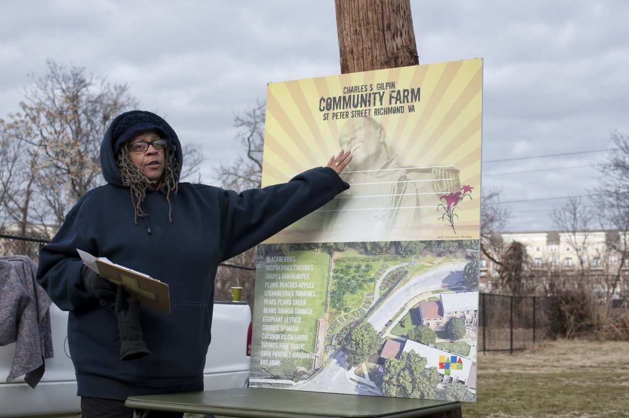 woman shows schematic for community garden