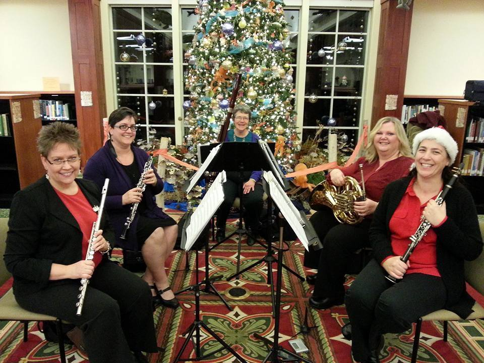 Chamber Chicks musical group -- four women with instruments getting ready to play.