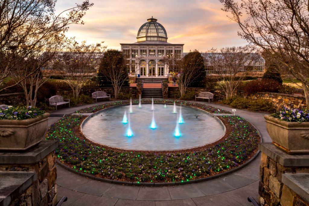 Lewis Ginter Botanical Garden's Conservatory illuminated at sunset during Dominion Energy GardenFest of Lights. Image by Tom Hennessy.