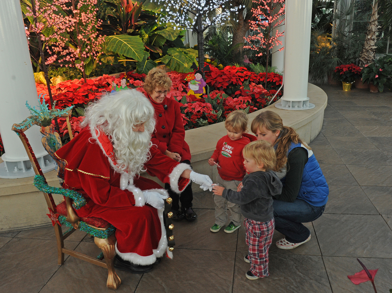Santa handing candy to child