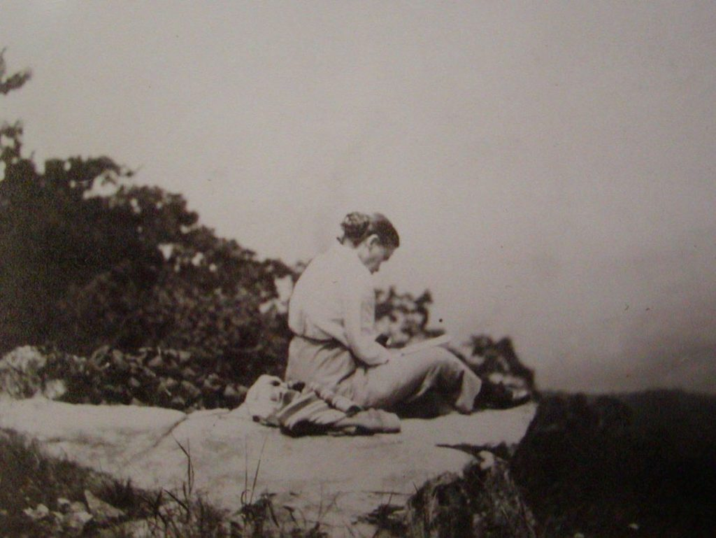 Image of Grace Arents on rock