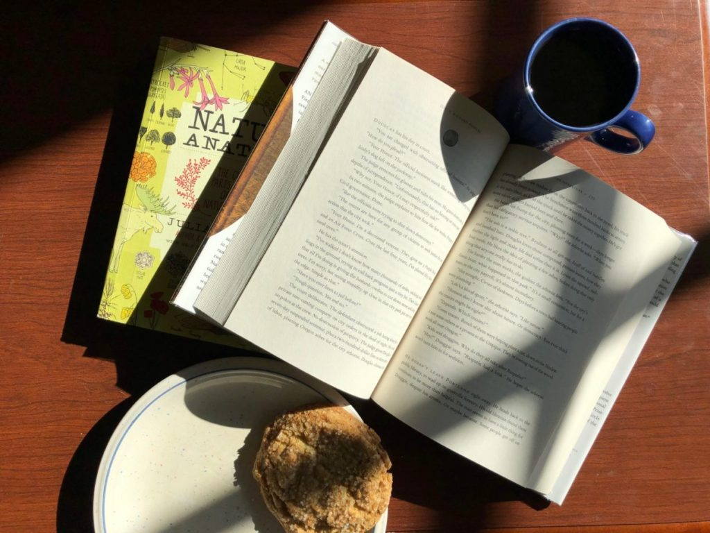 Two books, a cup of coffee, and a cookie