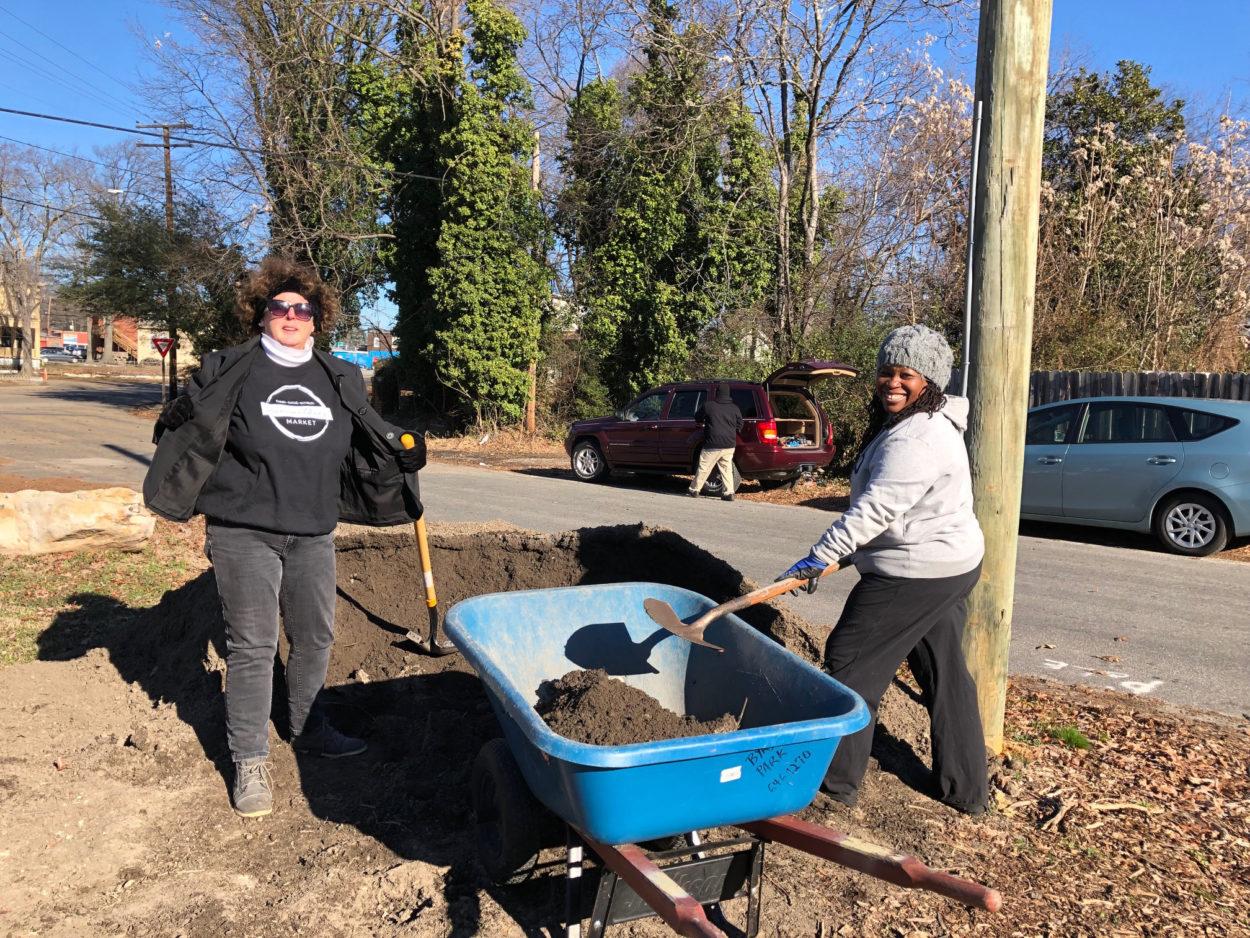 Two women gardening one of Richmond's urban gardens