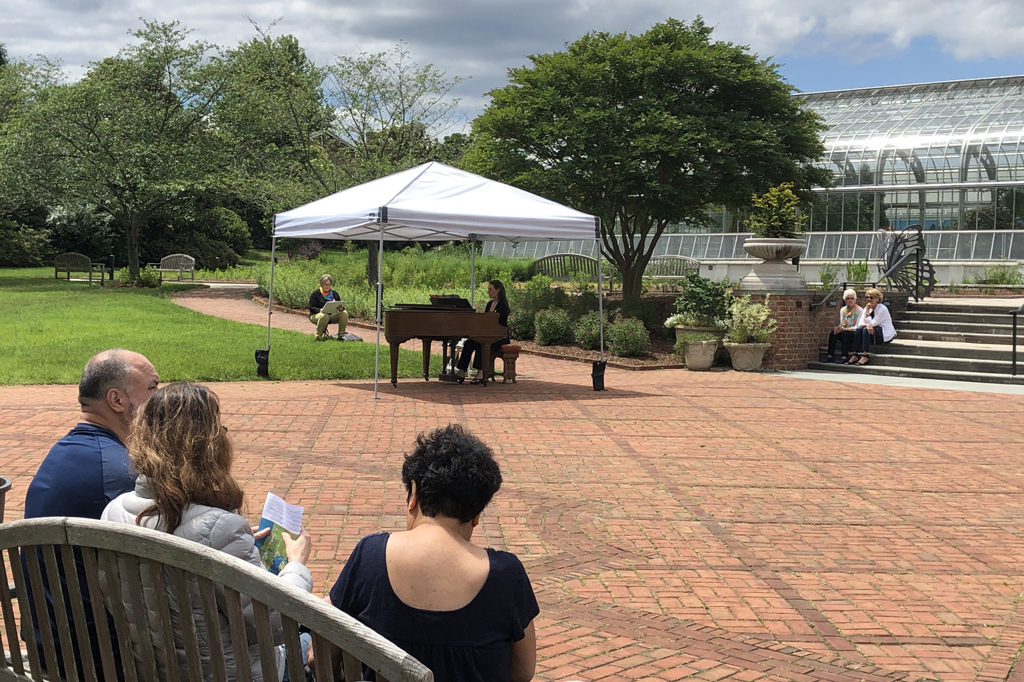 Guests listening to Pianos in Bloom