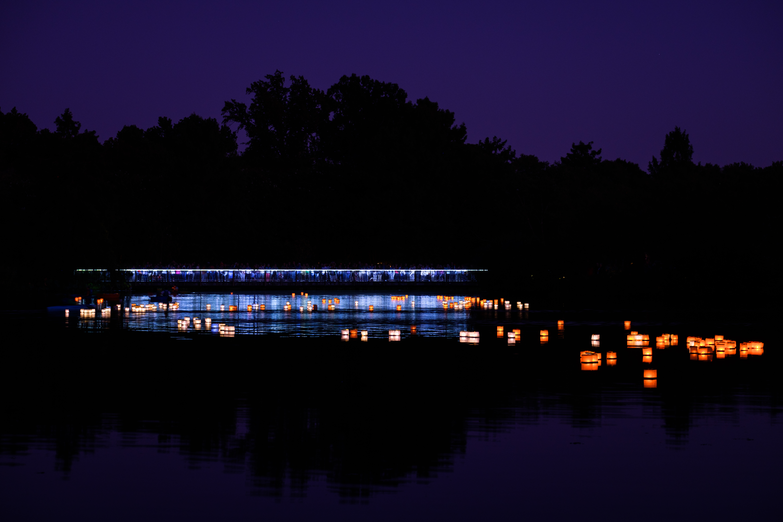 Toro nagashi floating lantern festival showing the lake at night with votives. Image by Harlow Chandler
