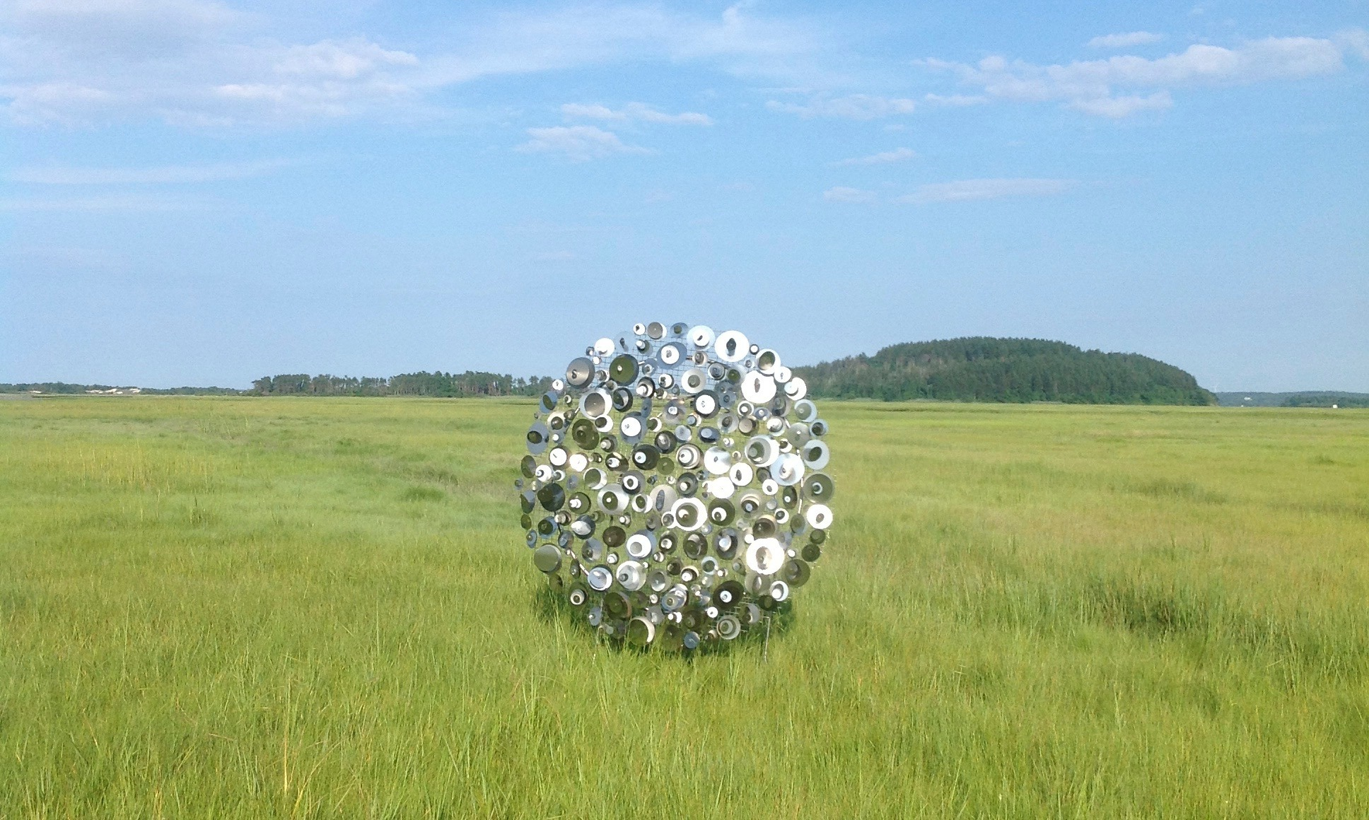 Silver circle sculpture from Wind, Waves and Light, by artist George Sherwood