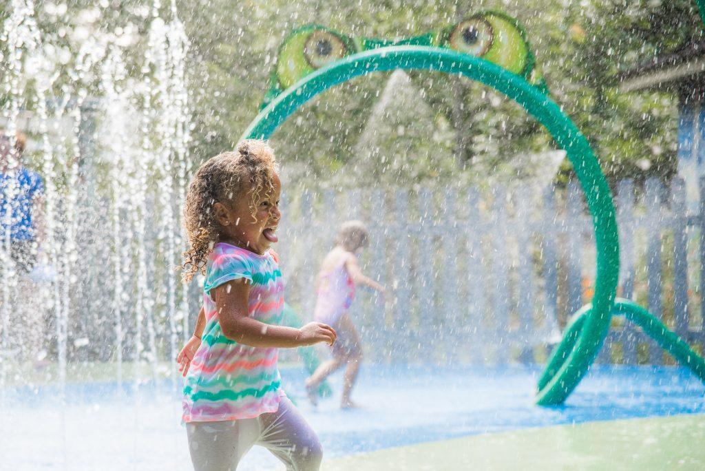 Girl splashing at waterplay