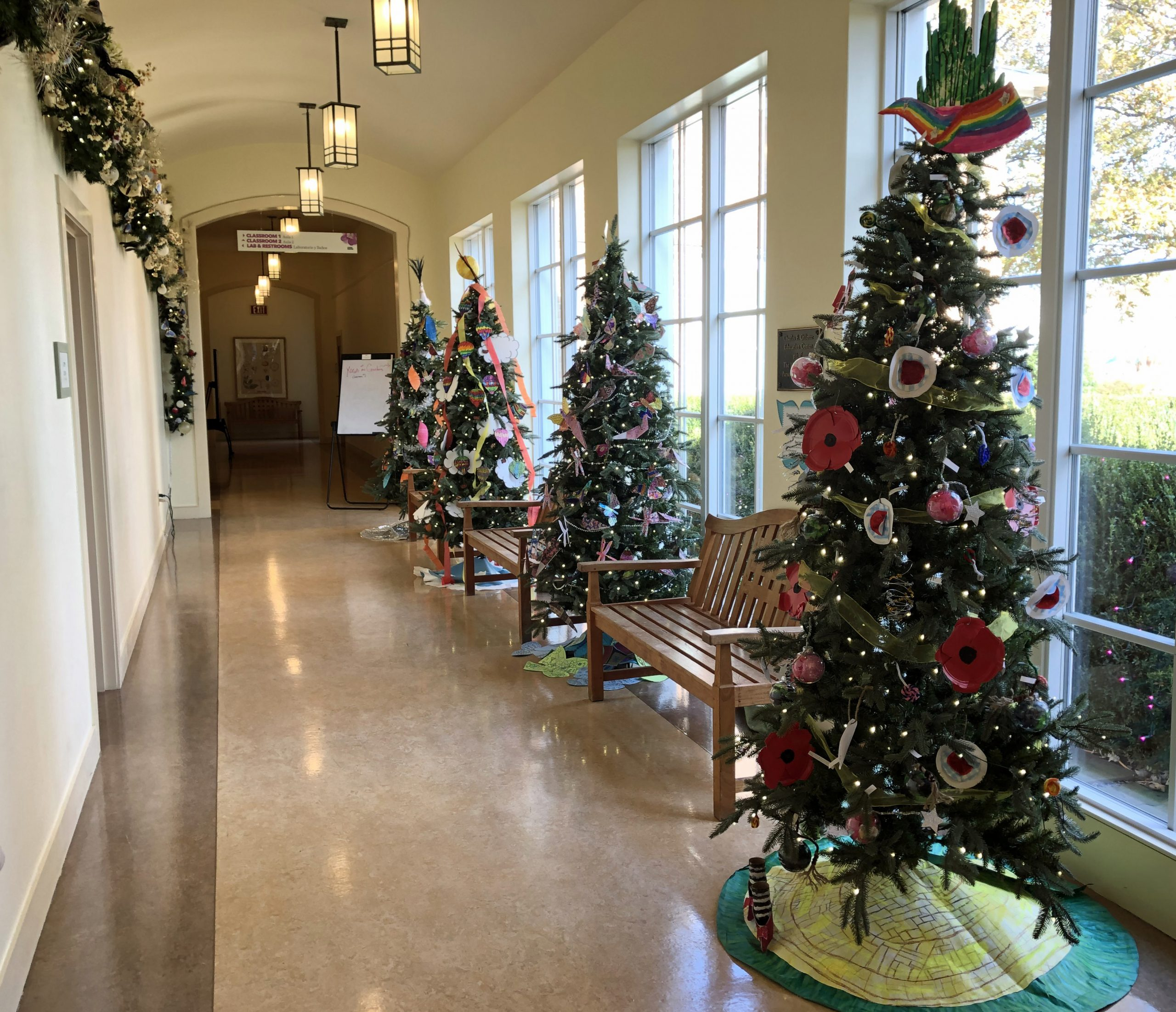 Hallway at Lewis Ginter Botanical Garden with holiday decorations on trees