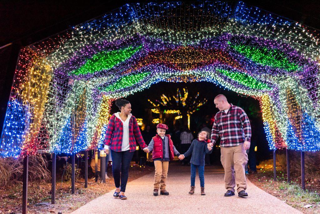 A family enjoying Dominion Energy GardenFest of Lights. Image by Caroline Martin