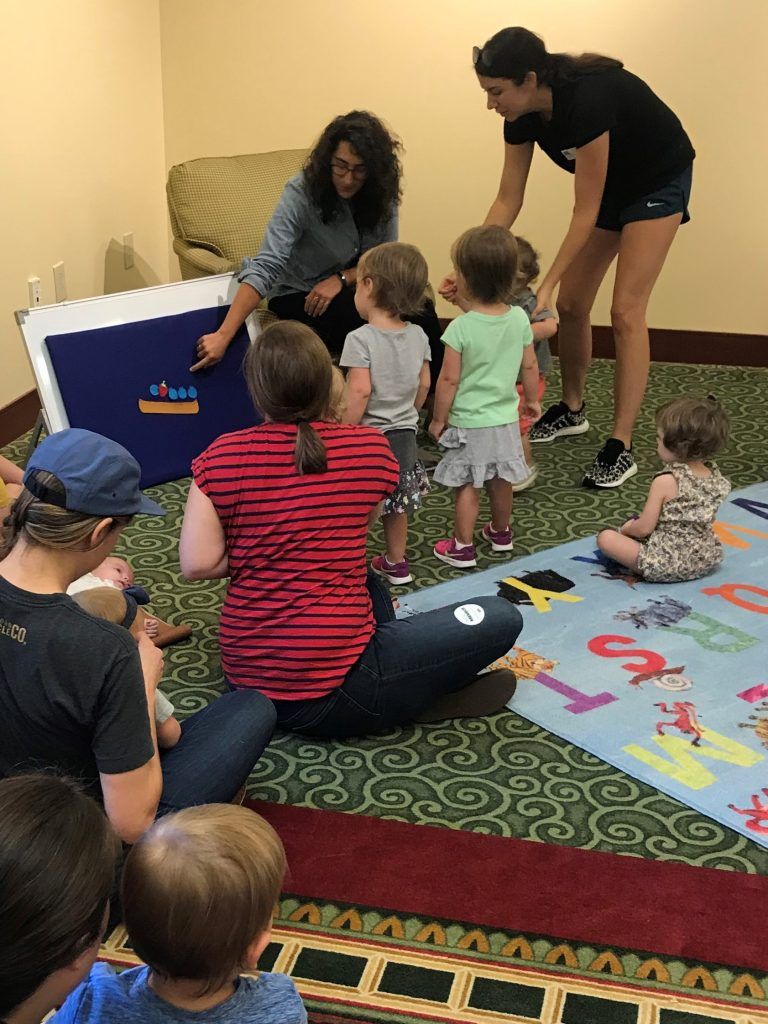 Children play with a felt board during storytime