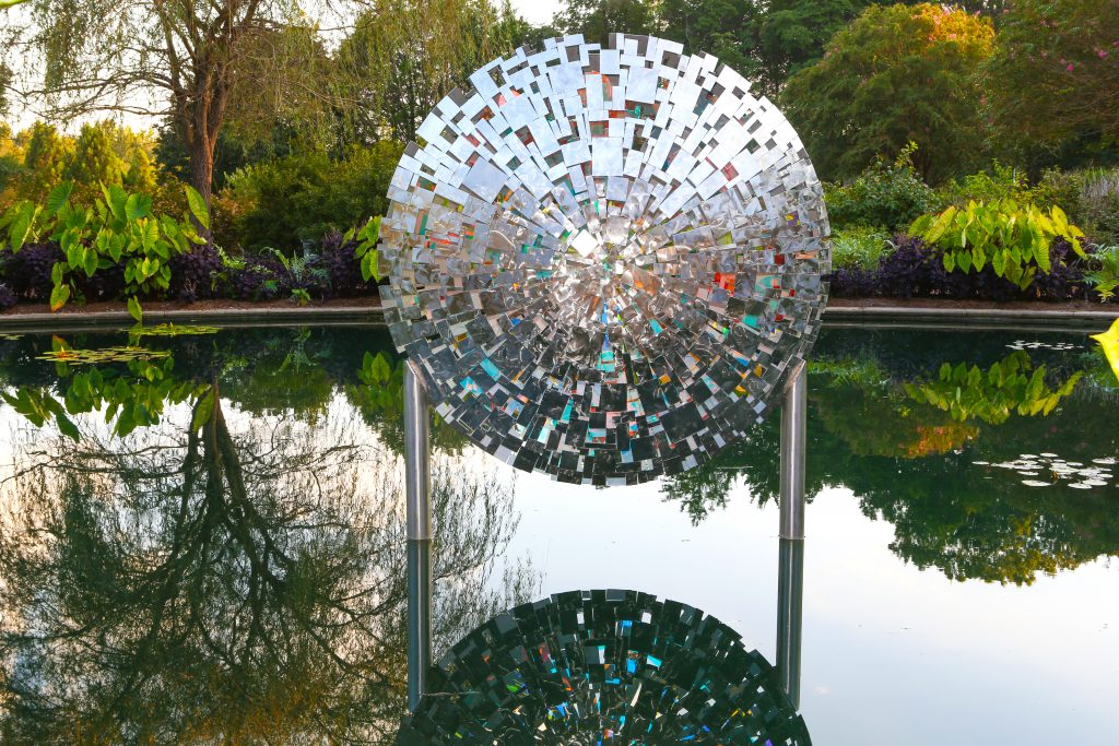 Colarium sculpture floating above water