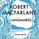 Book cover of Landmarks by Robert Macfarlane; a blue and white print depicts a forest opening into a clearing