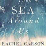Book cover for The Sea Around Us by Rachel Carson; a photo taken from above shows blue waves crashing into rocks