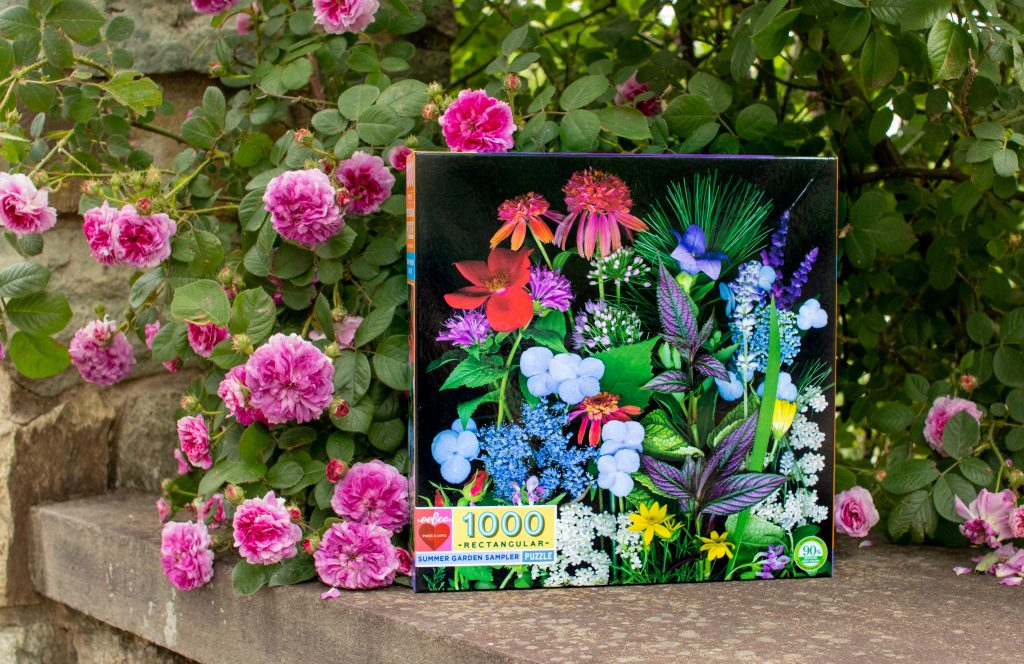 bright flower bouquet puzzle box in front of pink roses