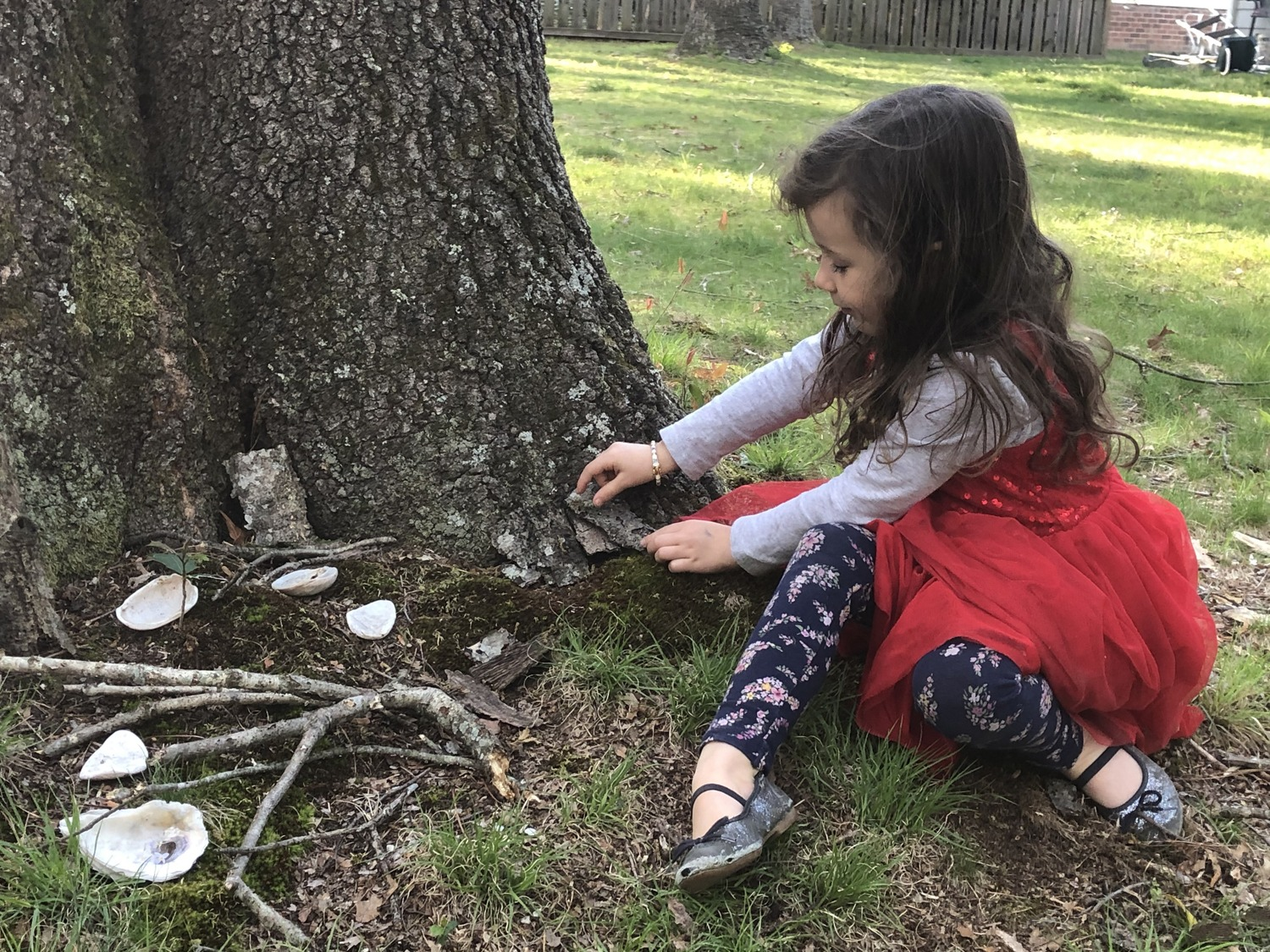 Making fairy houses in the back yard outdoor activities for kids