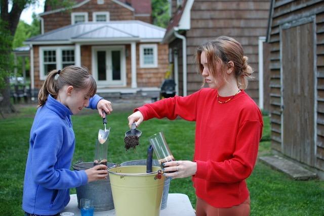 girls making a wormery