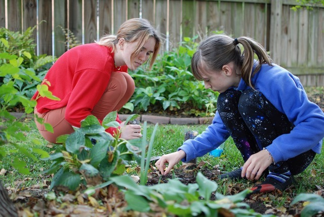 two girls gardening. Image by Mitra Bryant