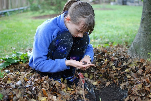 Girl working with soil. Image by Mitra Bryant