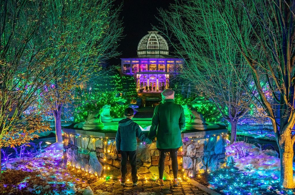 Family visiting Lewis Ginter GardenFest of Lights. Image by by Michael Simon