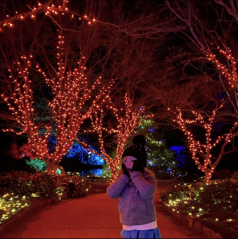 Girl looking amazed at all the lights. Image by Devin Pilson