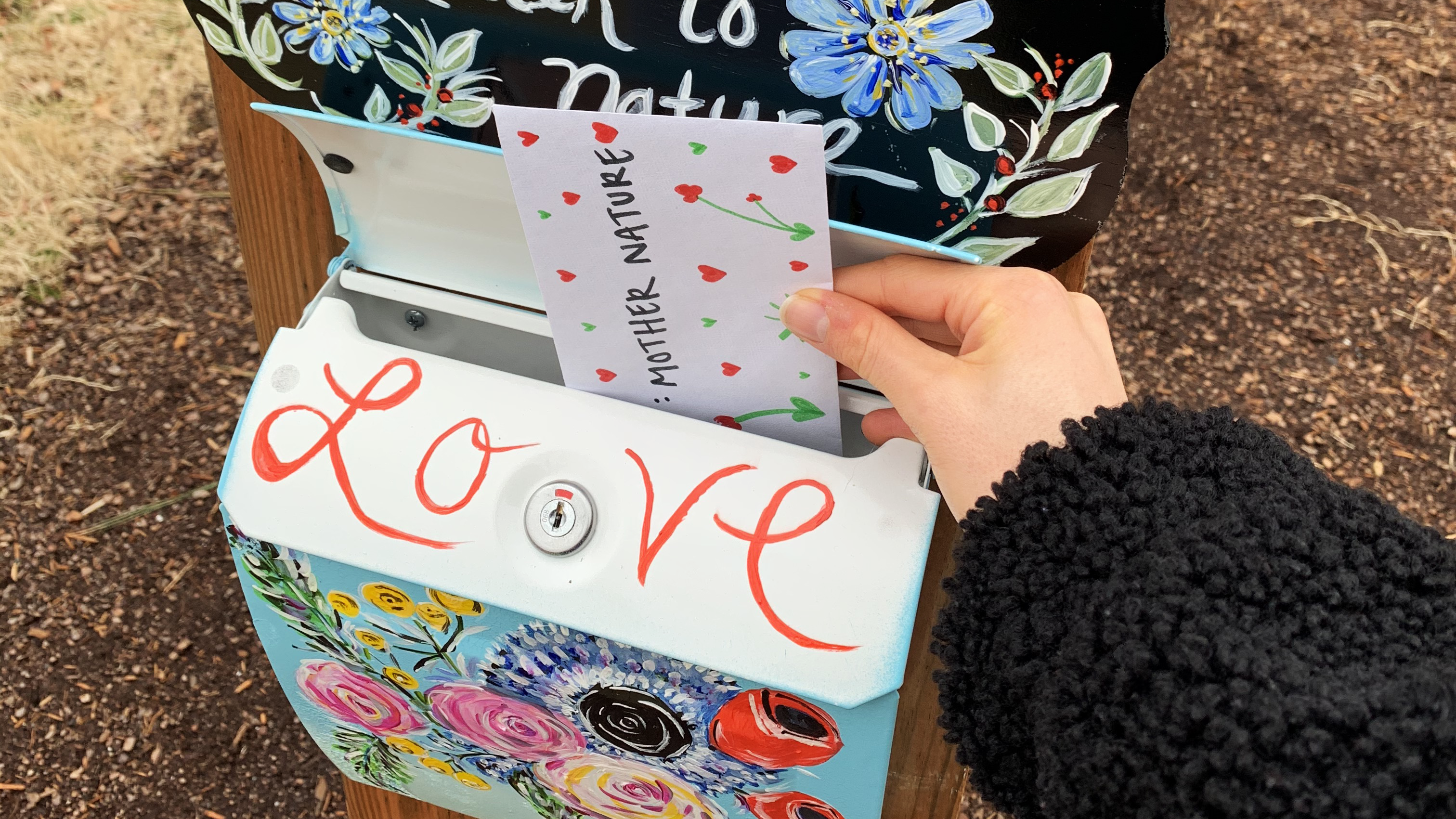 A love letter, addressed to Mother Nature, is being put into a mailbox at Lewis Ginter Botanical Garden.